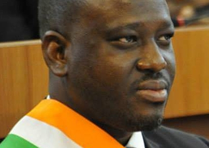 Guillaume Soro, du battle dress au complet veston